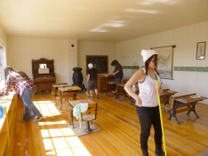 Students admired the one room log school house